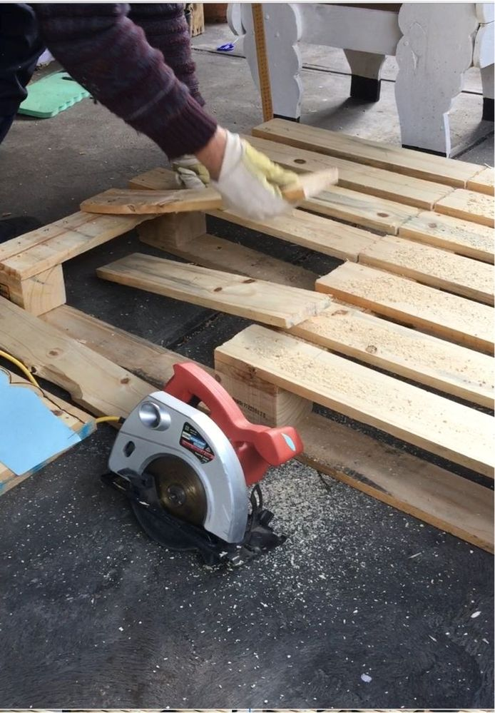 Lifting the slats up that will form the front and back.