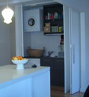 Hidden laundry in the kitchen area