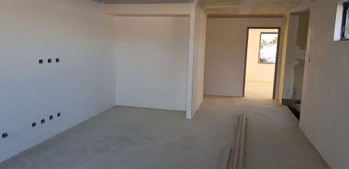 4.5 x 4.1m Retreat with fireplace. Opens onto Balcony.