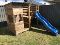 Marty constructed the cubby using pallet wood without plans