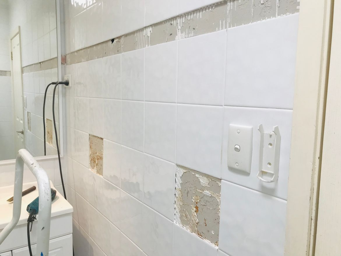 Remove old trim tiles and ceramic towle rail and soap holders etc..