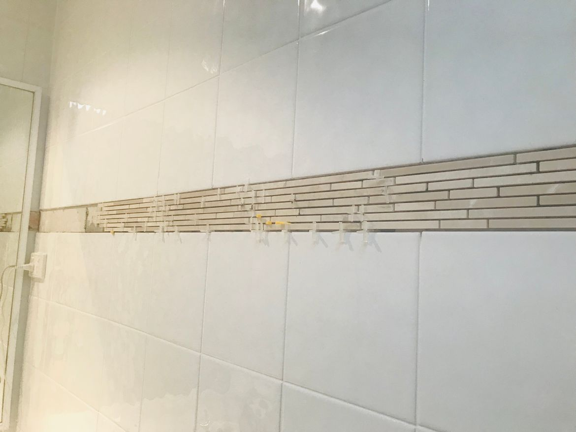 Trim tiles installed - very fidly work.  Will go for a different type of tile next time!