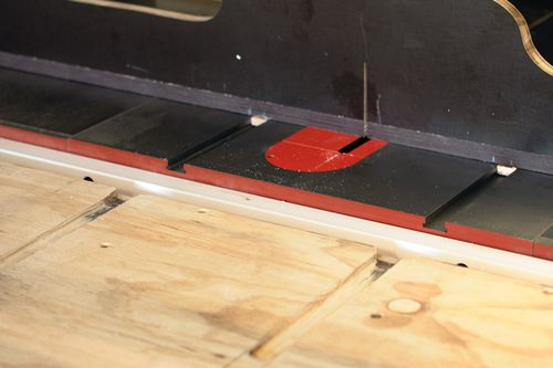 I routed out extensions of the saw's mitre slots so that the crosscut sled, or any others, could move forward with the outfeed table in place.