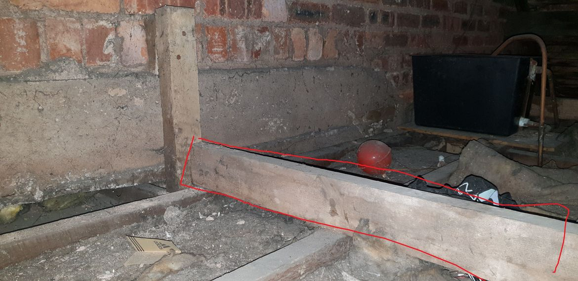 beam goes into joist at end of building which is cemented into place