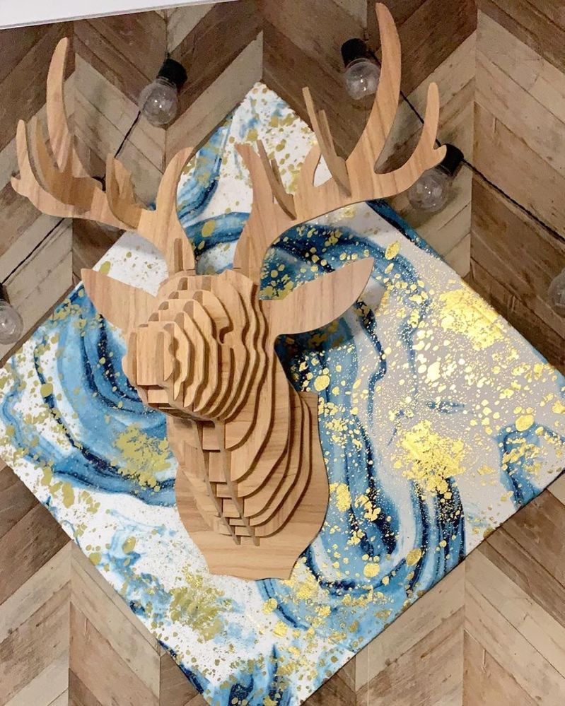 antler head on fabric back board