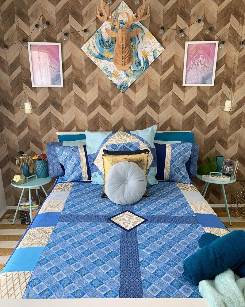 hand made quilt and cushions. wood look wallpaper