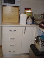 4 drawers & 1/2 a cupboard which Ive slid pans etc on there sides same with the other 2 half cupboards in my new kitchen.