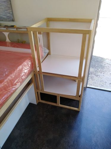 The frame is fastened through the walls to the caravan frame and into the floor