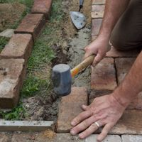 9.2 Reposition border pavers and tamp back down until aligned.jpg