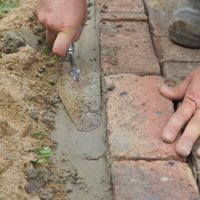 10. Use a trowel to pack concrete firmly.jpg