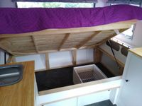 Underbed storage with gas struts for full access and sliding doors for quick access