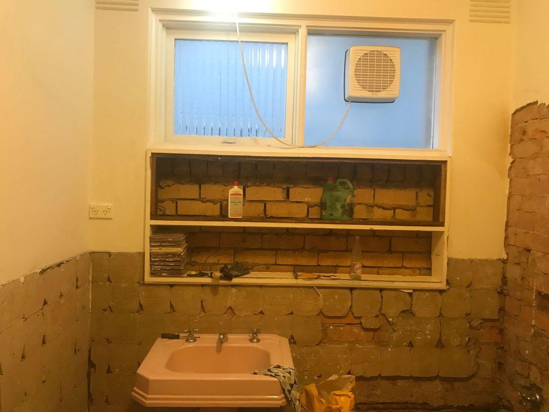Bathroom cupboard demolished to insert a cavity shelf - probably tiled
