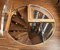Spiral-staicase-leading-into-a-wine-cellar-that-saves-up-on-space.jpg