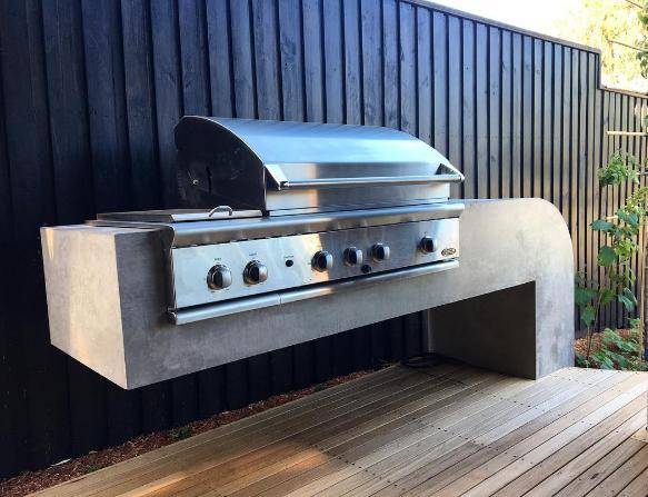 Cantilevered concrete BBQ bench impressionslandscapedesign.png
