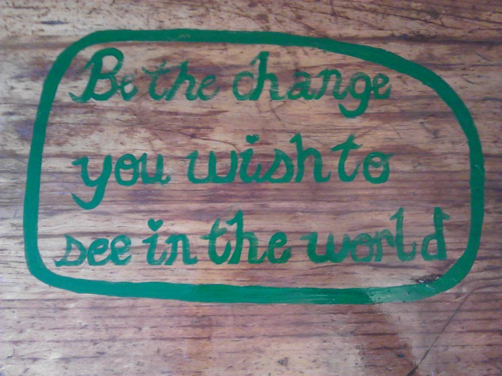 I bought this table for $10 at a garage sale, sanded it back and pinted my motto in the centre.  I then gave it 2 coats of lacquer. I think it came up a treat.