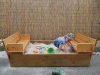 Sandpit with fold-out seats